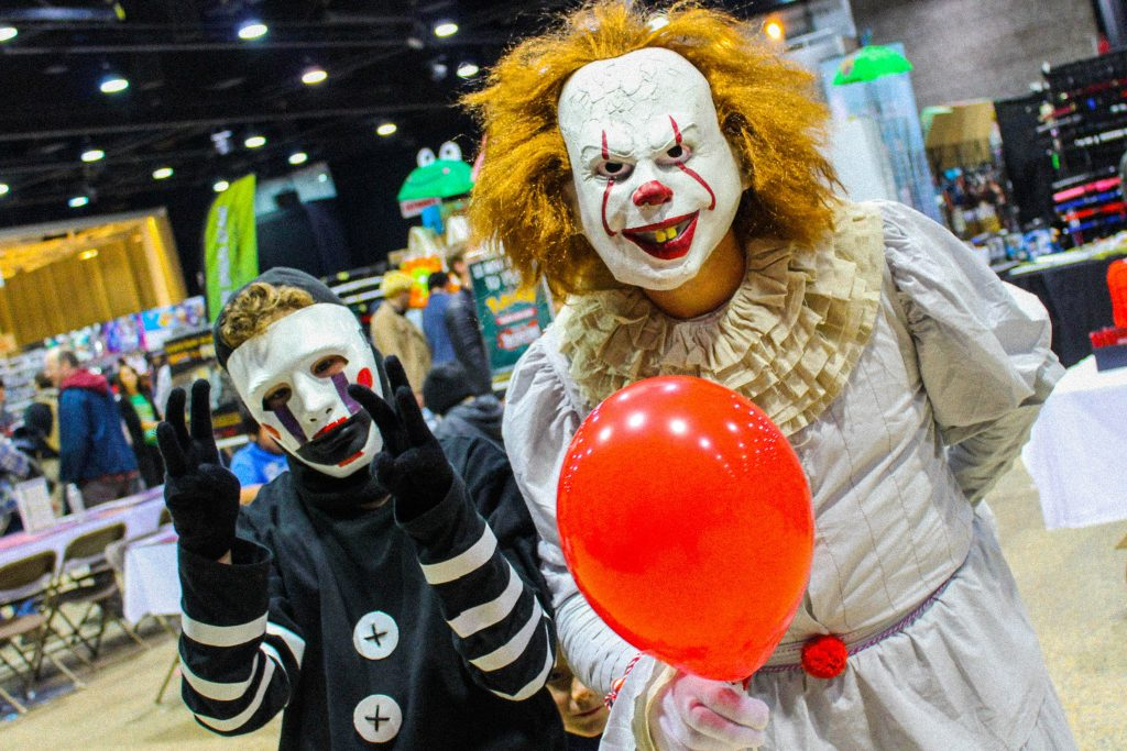 Norm Smith put on his best Pennywise the Dancing Clown impression at C4 on Saturday Oct. 28, 2017, accompanied by his kids, one of whom was cosplaying as The Puppet from Five Nights at Freddy's./Gabrielle Bruce